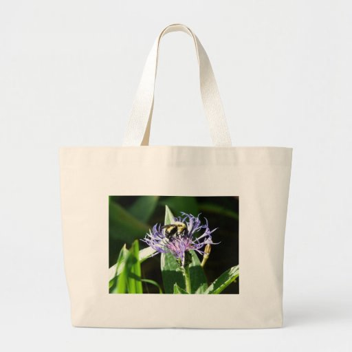 bumble bee,on a bachelor button canvas bag