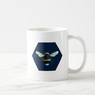 Bumble bee on a white mug