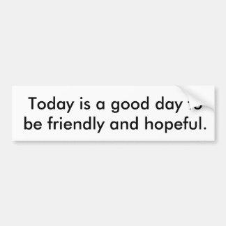 Bumper sticker saying be friendly & hopeful.
