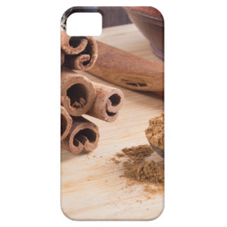 Bunch of cinnamon sticks and vintage silver spoon iPhone 5 covers