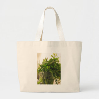 Bunch of fresh herbs from garden large tote bag