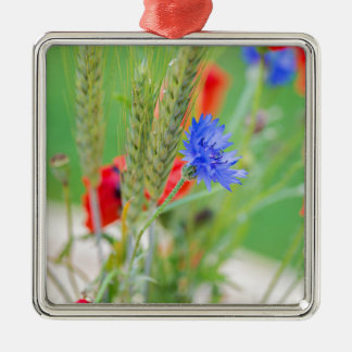 Bunch of of red poppies, cornflowers and ears metal ornament