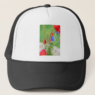 Bunch of of red poppies, cornflowers and ears trucker hat