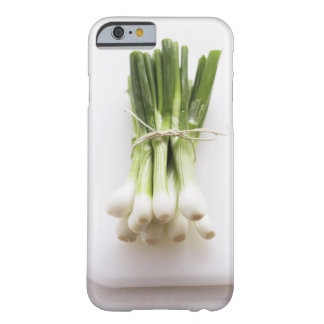 Bunch of spring onions on white chopping board barely there iPhone 6 case
