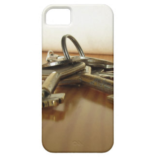 Bunch of worn house keys on wooden table barely there iPhone 5 case