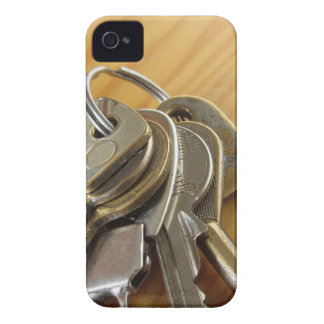 Bunch of worn house keys on wooden table Case-Mate iPhone 4 case