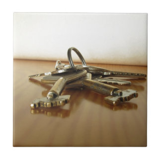 Bunch of worn house keys on wooden table ceramic tile