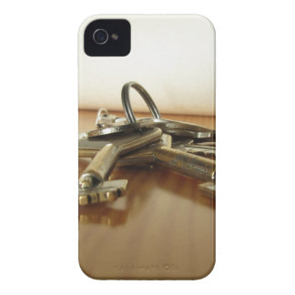 Bunch of worn house keys on wooden table iPhone 4 Case-Mate case