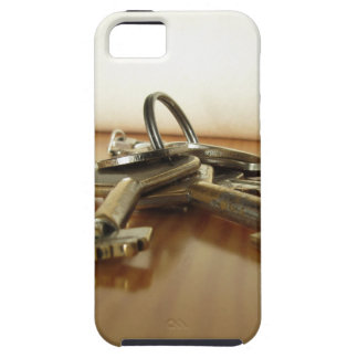 Bunch of worn house keys on wooden table iPhone 5 case