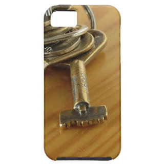 Bunch of worn house keys on wooden table iPhone 5 cases