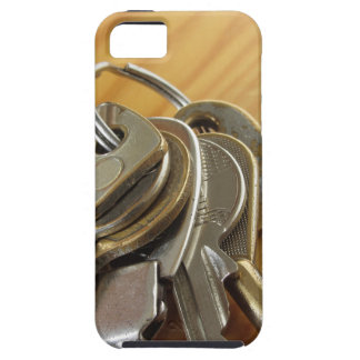 Bunch of worn house keys on wooden table iPhone 5 cover