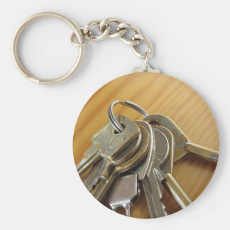 Bunch of worn house keys on wooden table key ring