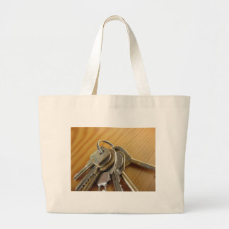 Bunch of worn house keys on wooden table large tote bag