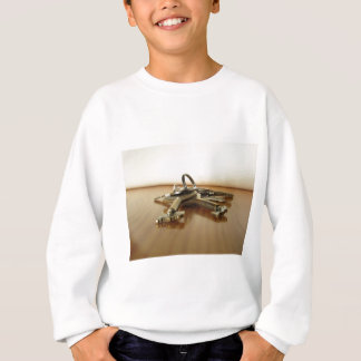 Bunch of worn house keys on wooden table sweatshirt