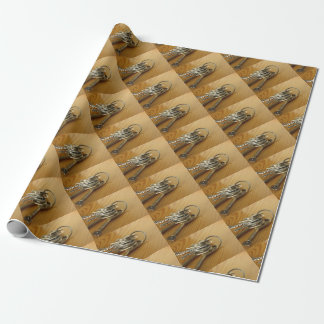 Bunch of worn house keys on wooden table wrapping paper