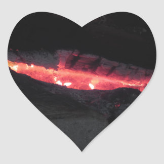 Burning fireplace with fire flames on black heart sticker
