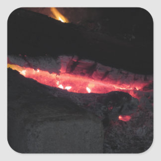 Burning fireplace with fire flames on black square sticker