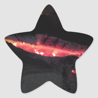 Burning fireplace with fire flames on black star sticker