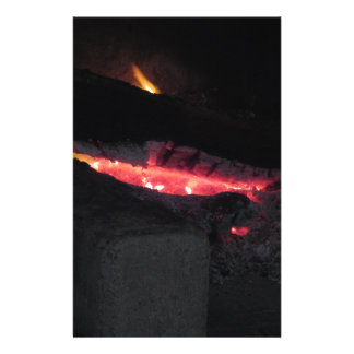 Burning fireplace with fire flames on black stationery