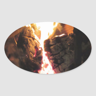 Burning fireplace with fire flames oval sticker