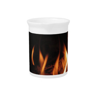 Burning fireplace with fire flames pitcher