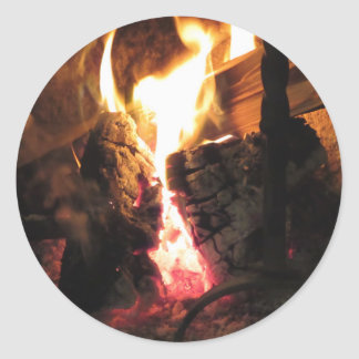 Burning fireplace with fire flames round sticker