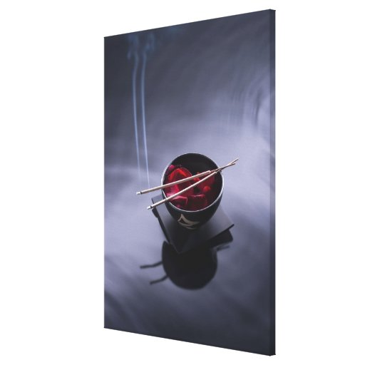 Burning incense on top of bowl of petals stretched canvas print