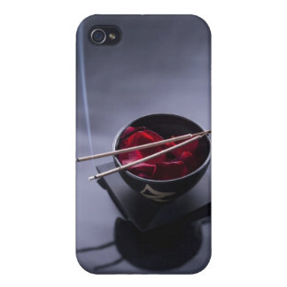 Burning incense on top of bowl of petals iPhone 4/4S cases