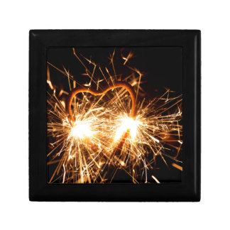 Burning sparkler in form of a heart gift box