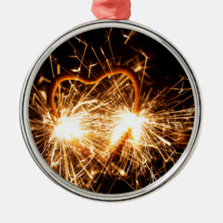 Burning sparkler in form of a heart metal ornament