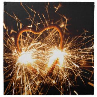 Burning sparkler in form of a heart napkin