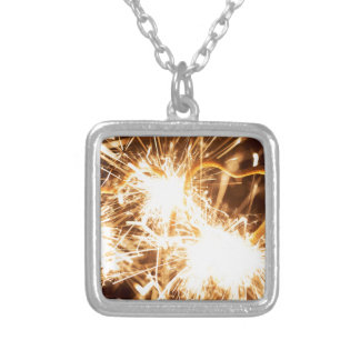 Burning sparkler in form of a heart silver plated necklace