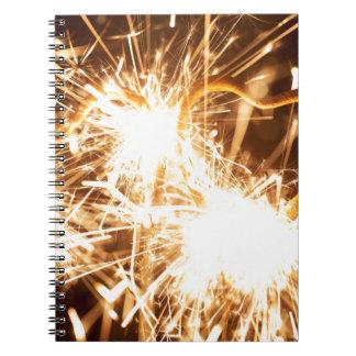 Burning sparkler in form of a heart spiral notebook