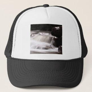 burst of water in creek trucker hat