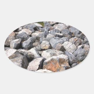 Bush setting of man made rock formation pattern oval sticker