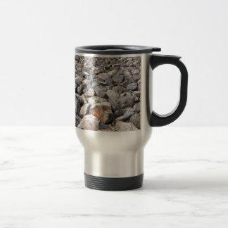 Bush setting of man made rock formation pattern stainless steel travel mug