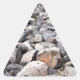 Bush setting of man made rock formation pattern triangle sticker