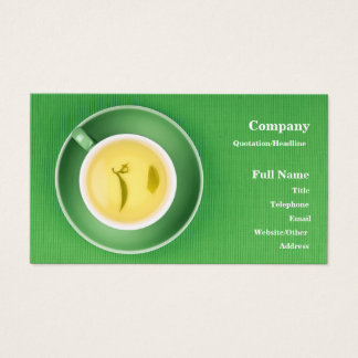 Business Card with green tea cup over green textil