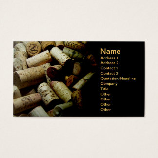 business card with pile of bottle corks