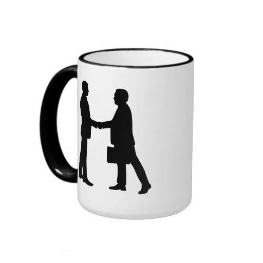 Business men shake hands coffee mug