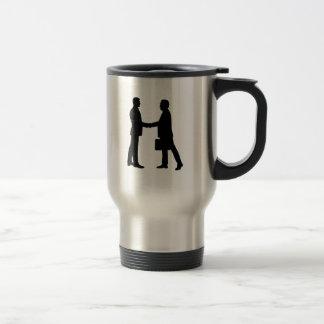 Business men shake hands coffee mugs