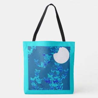 Butterflies against blue night sky, moonscape tote bag