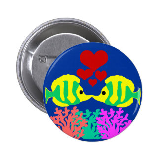 Butterfly Fish kissing over the coral button