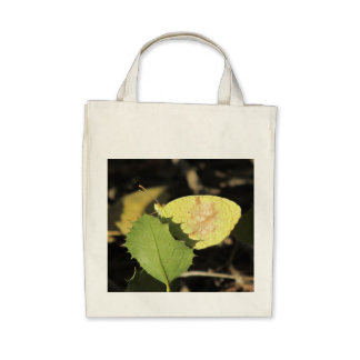 Butterfly Hiding Behind a Leaf Canvas Bags