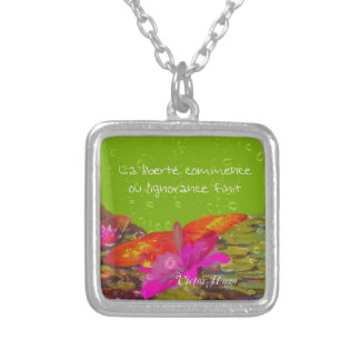 Butterfly in a pond. silver plated necklace