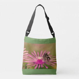 Butterfly on a purple wild flower crossbody bag