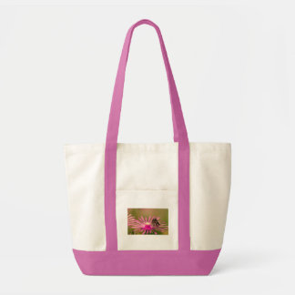 Butterfly on a purple wild flower tote bag
