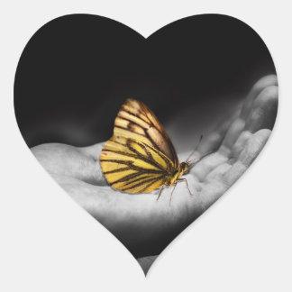 Butterfly on hand heart sticker