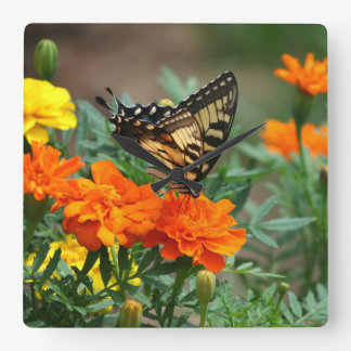 Butterfly on Orange and Yellow Flowers Wall Clock