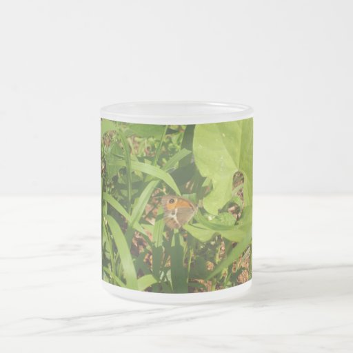 Butterfly on the grass mugs